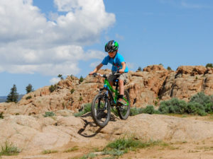 child mountain biking in Colorado